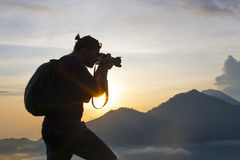 Photographer takes pictures on the mountain Royalty Free Stock Photography