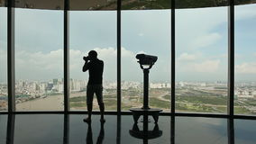 Photographer takes pictures on observation deck in tower Ho Chi Minh city. Observation deck tower in Ho Chi Minh city with tourists stock video