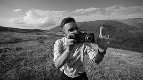 Photographer takes pictures with retro camera stock footage