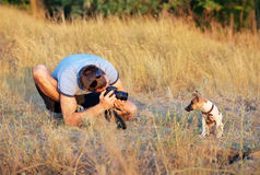 Photographer takes pictures of a small puppy Royalty Free Stock Image