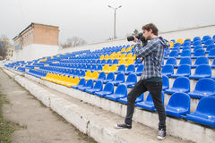 A photographer takes pictures at the stadium. No people Royalty Free Stock Images