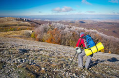Photographer takes pictures on top of the mountain Stock Photo