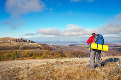 Photographer takes pictures on top of the mountain in autumn. Stock Photos