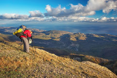 Photographer takes pictures on top of the mountain in autumn. Stock Photo