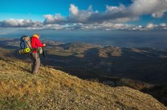 Photographer takes pictures on top of the mountain in autumn Stock Images