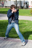 Photographer Takes a Shot. By standing Royalty Free Stock Photography