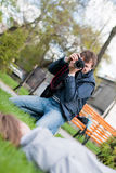 Photographer Takes a Shot of a model. Photographer Takes a Shot of the model on Green Grass Royalty Free Stock Image