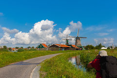 Photographer takes windmills in Zaanse Schans, Hol Stock Photography