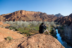 Photographer taking a landscape photo of gorgeous Dades Gorge valley Royalty Free Stock Images