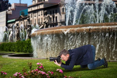 Photographer taking macro picture of flowers Royalty Free Stock Image
