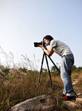 Photographer taking photo Stock Photos
