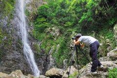 Photographer taking photo Stock Images