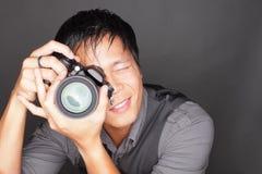 Photographer taking a photo Stock Photos