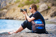 Photographer is taking a photo at the beach Royalty Free Stock Images