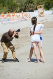 Photographer taking photo on beach Royalty Free Stock Photo