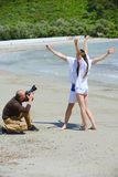 Photographer taking photo on beach Stock Photography
