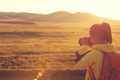 Photographer taking photo. In beautiful landscape Stock Images