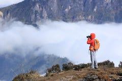 Photographer taking photo for beautiful landscape Royalty Free Stock Photo