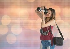 Photographer taking a photo. blue and orange blurred lights. Digital composite of photographer taking a photo. blue and orange blurred lights Stock Photos