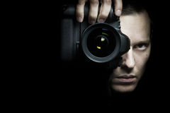 Photographer taking photo with camera Royalty Free Stock Photography