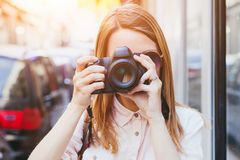Photographer taking photo with dslr professional camera stock photography