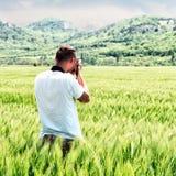 Photographer taking photo Stock Photos
