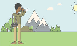Photographer taking photo in mountains Stock Image