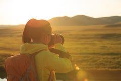 Photographer taking photo. In beautiful landscape Stock Image