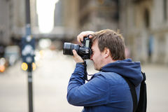 Photographer taking photo with professional digital camera Royalty Free Stock Photography