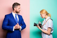 Photographer taking photo successful businessman. Paparazzi concept. Photosession for business magazine. Handsome. Businessman posing camera. Nice shot. Fame stock photo