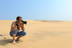 Photographer taking photos at the beach Stock Image