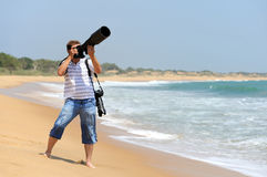 Photographer taking photos at the beach Stock Photo