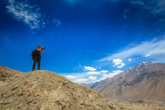 Photographer taking photos in Himalayas Royalty Free Stock Photography