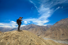 Photographer taking photos in Himalayas Royalty Free Stock Photo