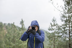 Photographer taking photos in the mountains. Stock Photos