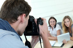 Photographer taking photos of women models Royalty Free Stock Photo