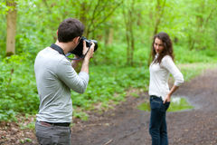 Photographer taking picture of an attractive model Royalty Free Stock Photography