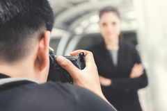 Photographer taking picture of businesswoman Stock Image