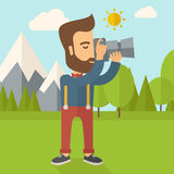 Photographer taking a picture. A Caucasian photographer taking a picture with the trees under the sun. Vector flat design illustration. Square layout Stock Photos