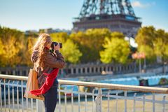 Photographer taking picture of the Eiffel tower Stock Photo
