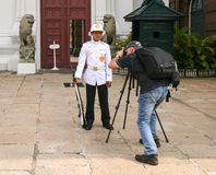 Photographer taking a picture of guard in grand palace in bangkok ,thailand Royalty Free Stock Image