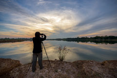 Photographer is taking a picture Royalty Free Stock Images