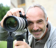 Photographer taking picture with modern camera Royalty Free Stock Photo