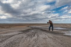 Photographer by the mud volcano royalty free stock photos