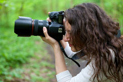 Photographer taking picture in the nature Royalty Free Stock Photos