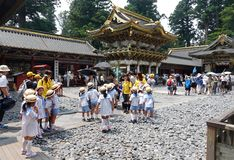 Photographer taking  picture of school kids in Nikko, Japan