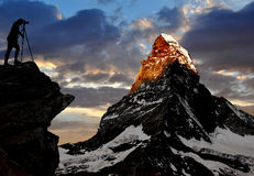 Photographer taking a picture. The sunrise over the Matterhorn-Swiss Alps Stock Photo