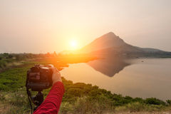 Photographer is taking a picture of sunset Royalty Free Stock Photos