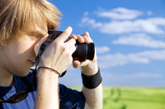 Photographer taking pictures Royalty Free Stock Images