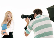 Photographer Taking Pictures. Of a Model in the Studio. It is not isolated Royalty Free Stock Image